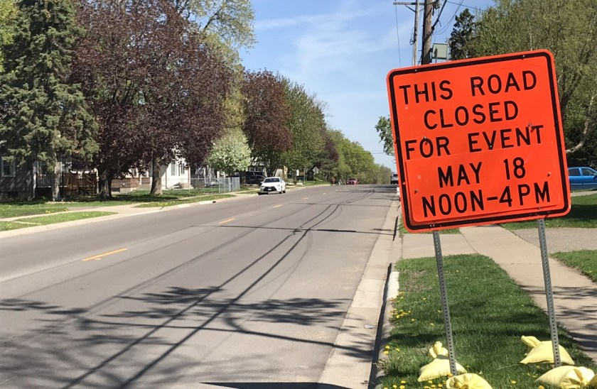 "Construction sign saying, ""This Road Closed for Event May 18 Noon-4PM"" on Charlton in West St. Paul for the West St. Paul Days parade."