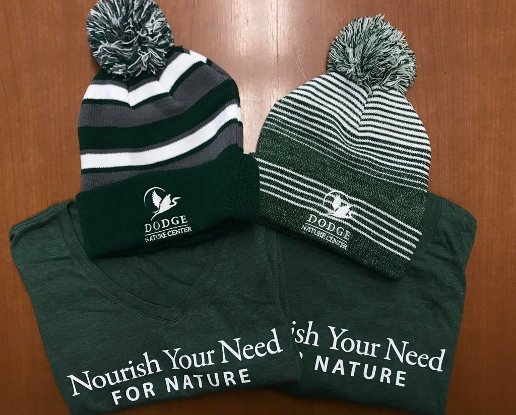 """Nourish Your Need for Nature"" shirts and Dodge Nature Center hats."