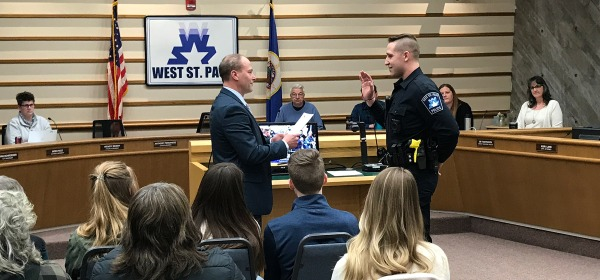 Mayor Dave Napier swearing in new West St. Paul Police Officer Aaron Stone