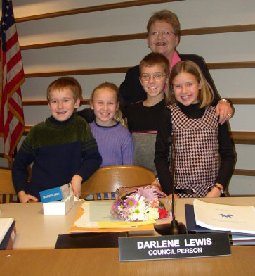 Council person Darlene Lewis in council chambers with her four grandchildren.