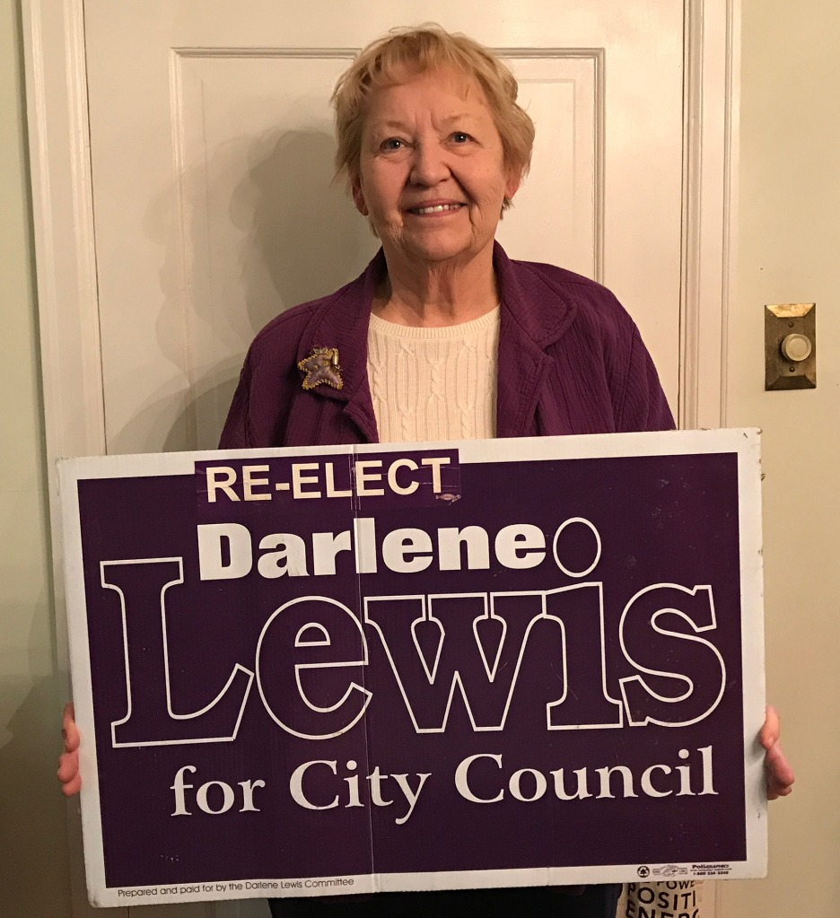 Former West St. Paul City Council Member Darlene Lewis with her campaign yard sign.
