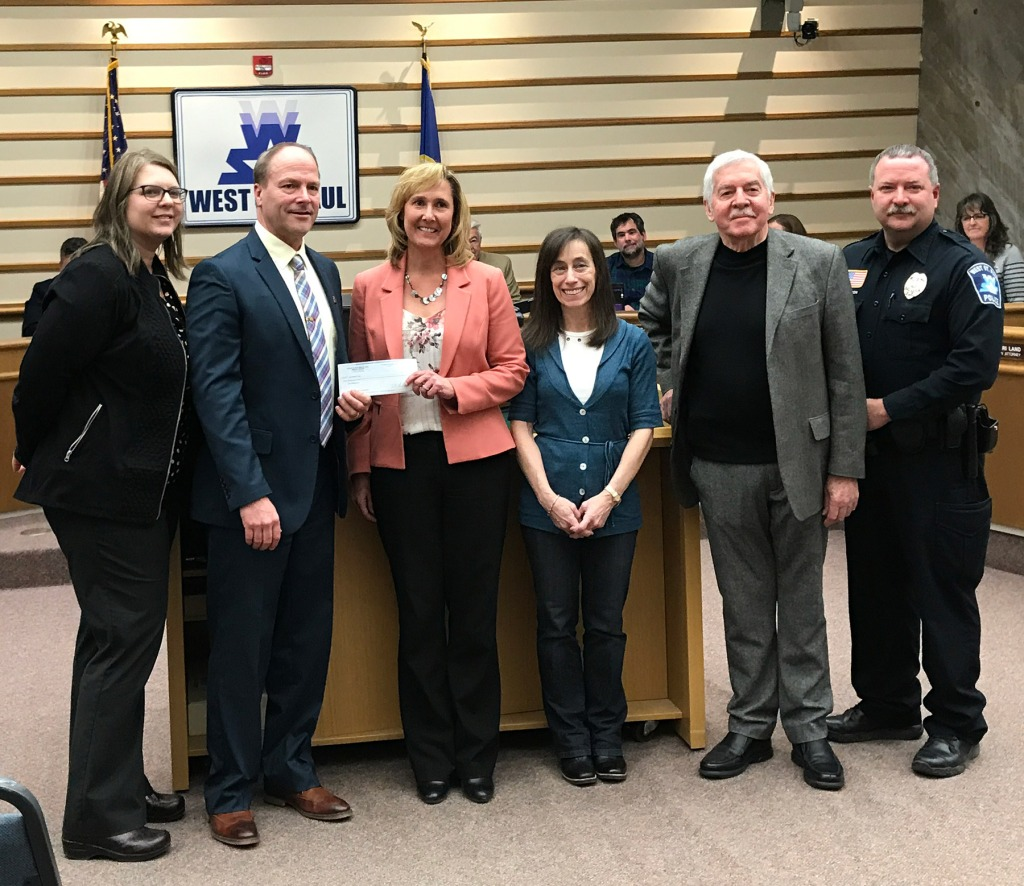 Rotary Club members presenting a check to West St. Paul Mayor Dave Napier.