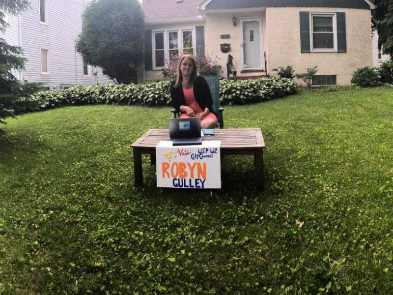 Ward 2 candidate Robyn Gulley campaigning in her front yard.
