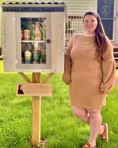 Polly Torkelson next to her Little Free Pantry