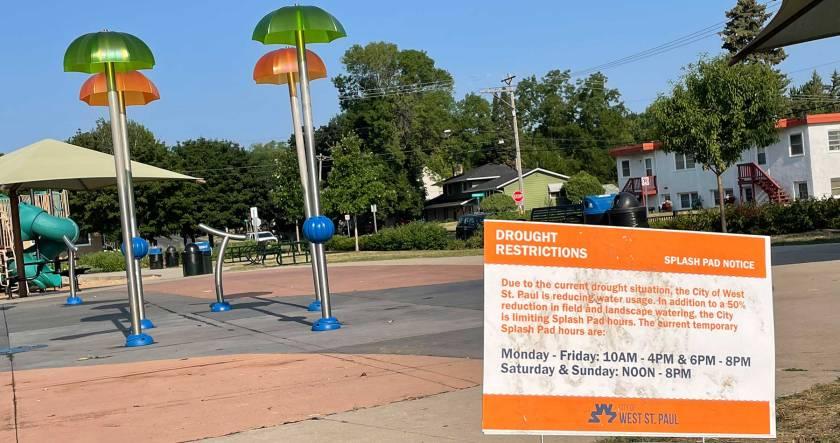 Drought restrictions sign at West St. Paul splash pad
