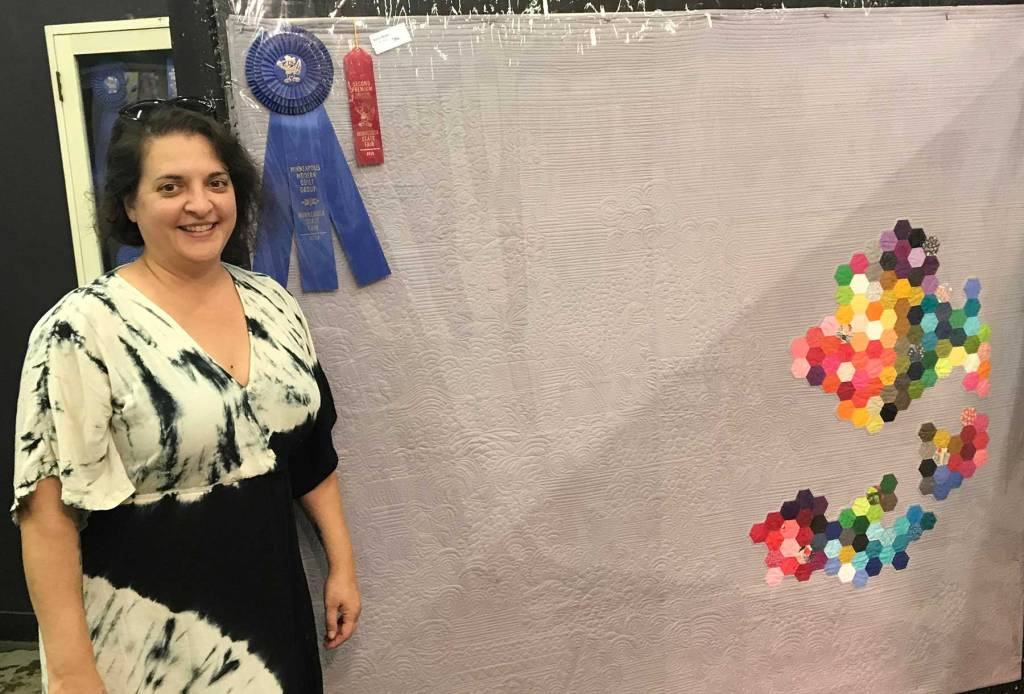 Darci Read and her Minnesota State Fair ribbon winning quilt