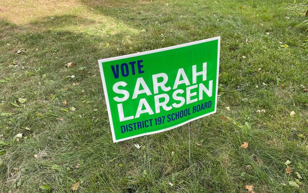 Sarah Larsen school board candidate sign