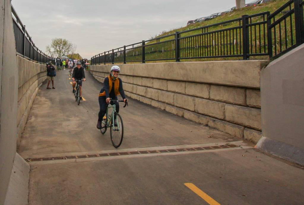 Biking through a the Robert Street underpass on the River-to-River Greenway Trail in West St. Paul.