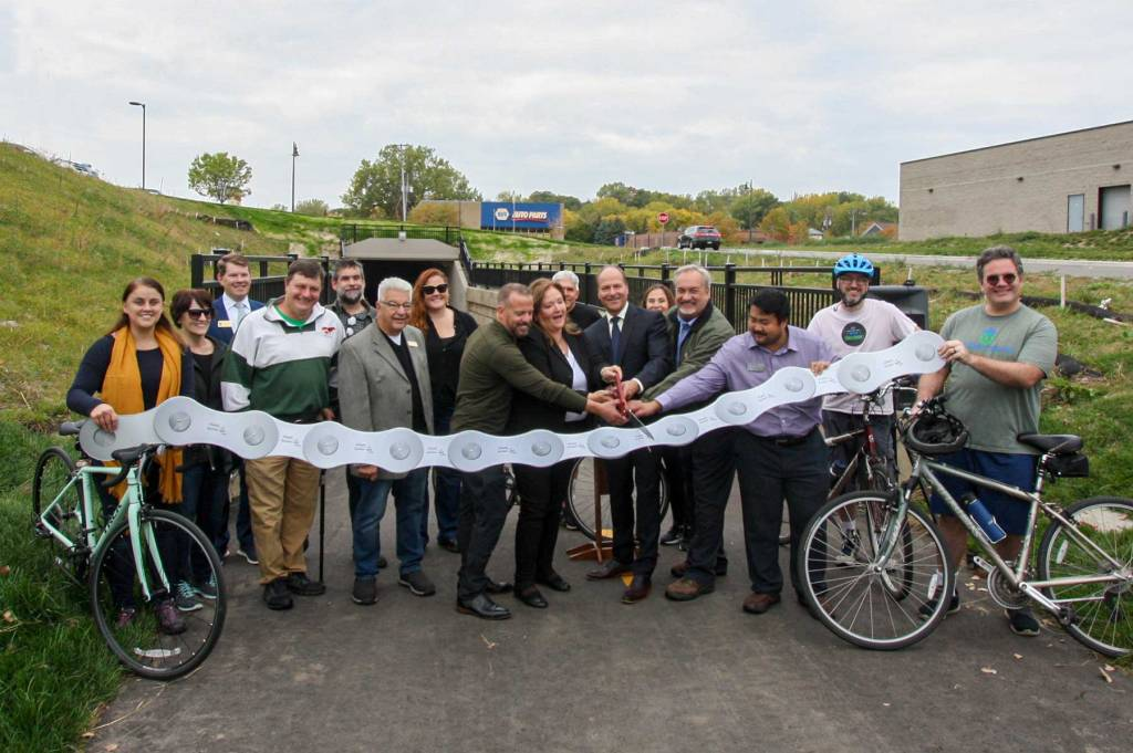 Ribbon-cutting ceremony at the Robert Street underpass on the River-to-River Greenway Trail.